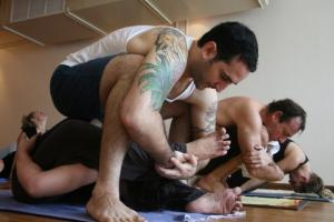 Greg adjusting Supta Kurmasana