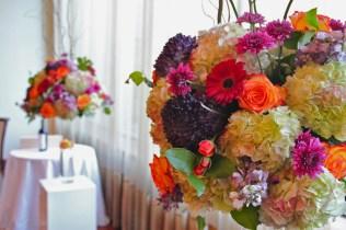 Fall Altar Pieces of hydrangea, roses, gerbera's, mums, and stock in jewel tones