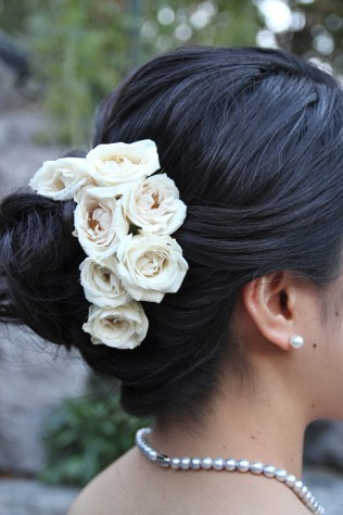 White spray roses in the bride's hairstyle