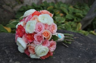 Peach, blush, coral and ivory rose and ranunculus bouquet