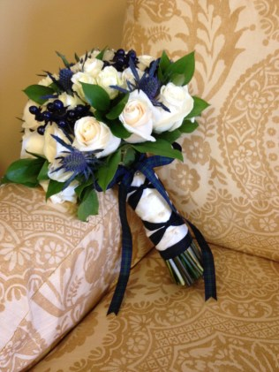 Cream, navy and green bouquet with scottish thistle