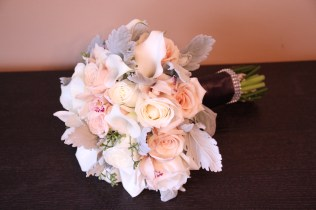 Winter Bouquet of roses, calla lilies, orchids and dusty miller