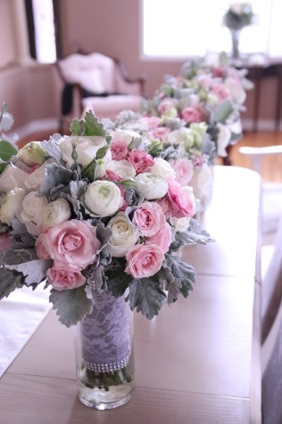 Vintage bridal bouquet of roses, spray roses, lisianthus, ranunculus & dusty miller