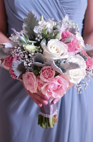 Vintage inspired bouquet of roses, spray roses, lisianthus, baby's breath and dusty miller