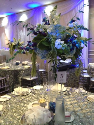 Ocean Inspired Centerpiece of Hydrangea, Snapdragons, Stock, Dendrobium Orchids and Amaranthus