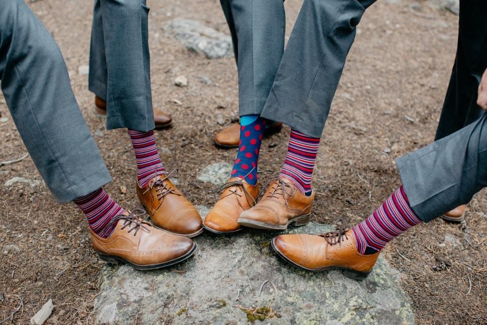 The groomsmen wore funky socks to add a little pizzaz to their wedding getup.