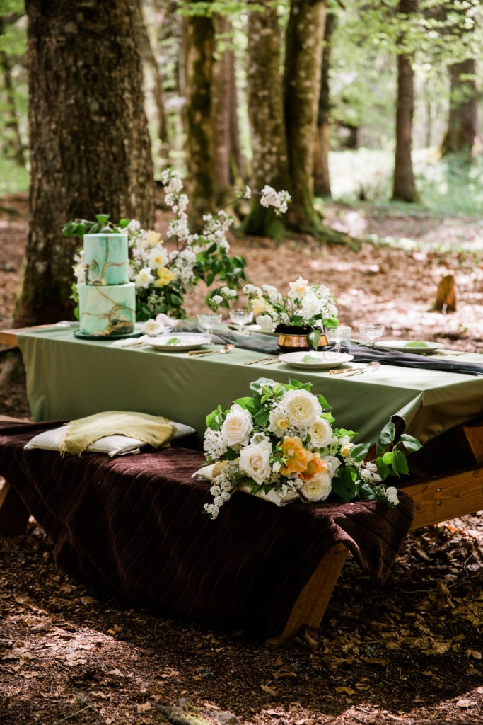 Gorgeous details, beautiful foraged florals and a few simple pops of color make for a stunning wedding picnic.