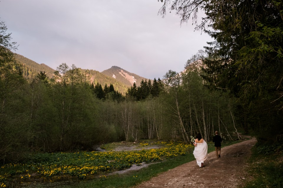 Pull up your dress and hike through the mud for your wedding.