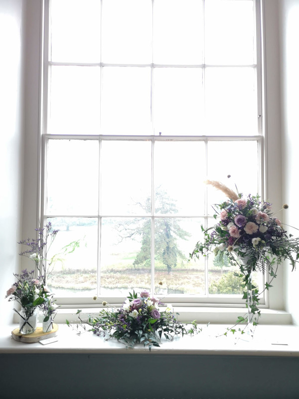 Flower arrangements in window