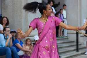 Woman in pink sari dancing.