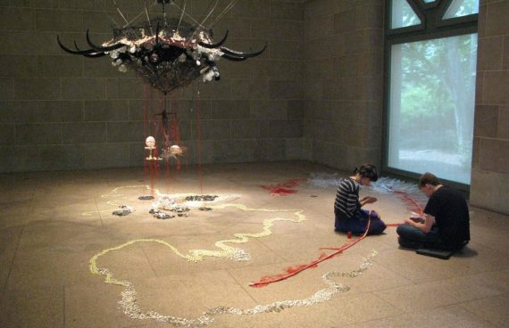 Working on the installation of Rina Banerjee's A World Lost in the Sackler pavilion