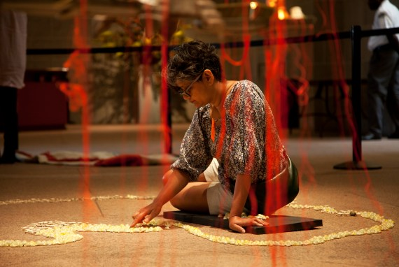"""Rina Banerjee installing """"A World Lost"""" in the Sackler Paviion."""