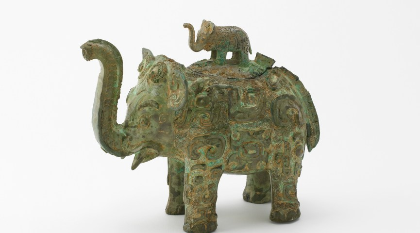 elephant with smaller elephant on top
