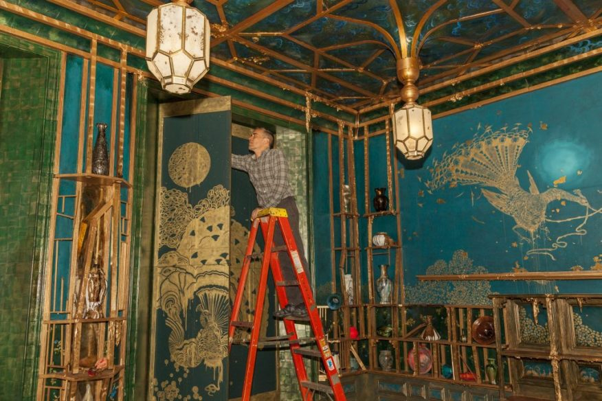 """Darren Waterston installing """"Filthy Lucre"""" in the Arthur M. Sackler Gallery"""