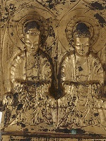 Relief of two gilded Buddhist figures seated side by side.