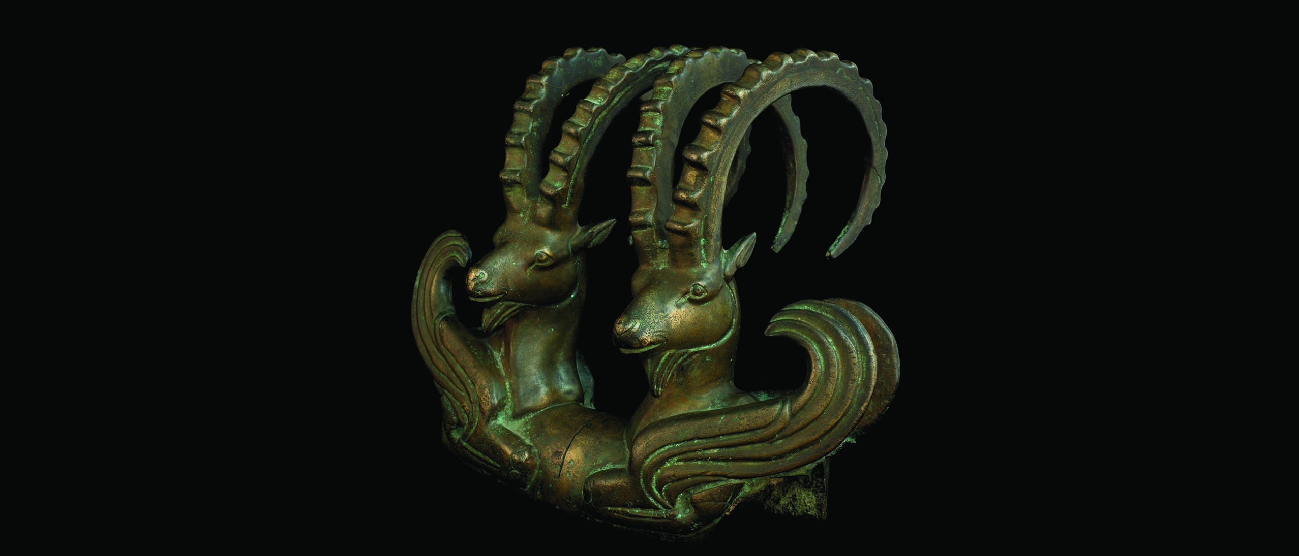 Image of Protome; 3rd-5th century B.C.E.; Protome of a pair of mountain goats with wings; Bronze; H x W: 17.5 x 4.2 cm; Central State Museum: KP 23732; Almaty, Kazakhstan