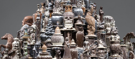 Ceramic readymades in blacks and browns, arranged in a dome like a stupa.