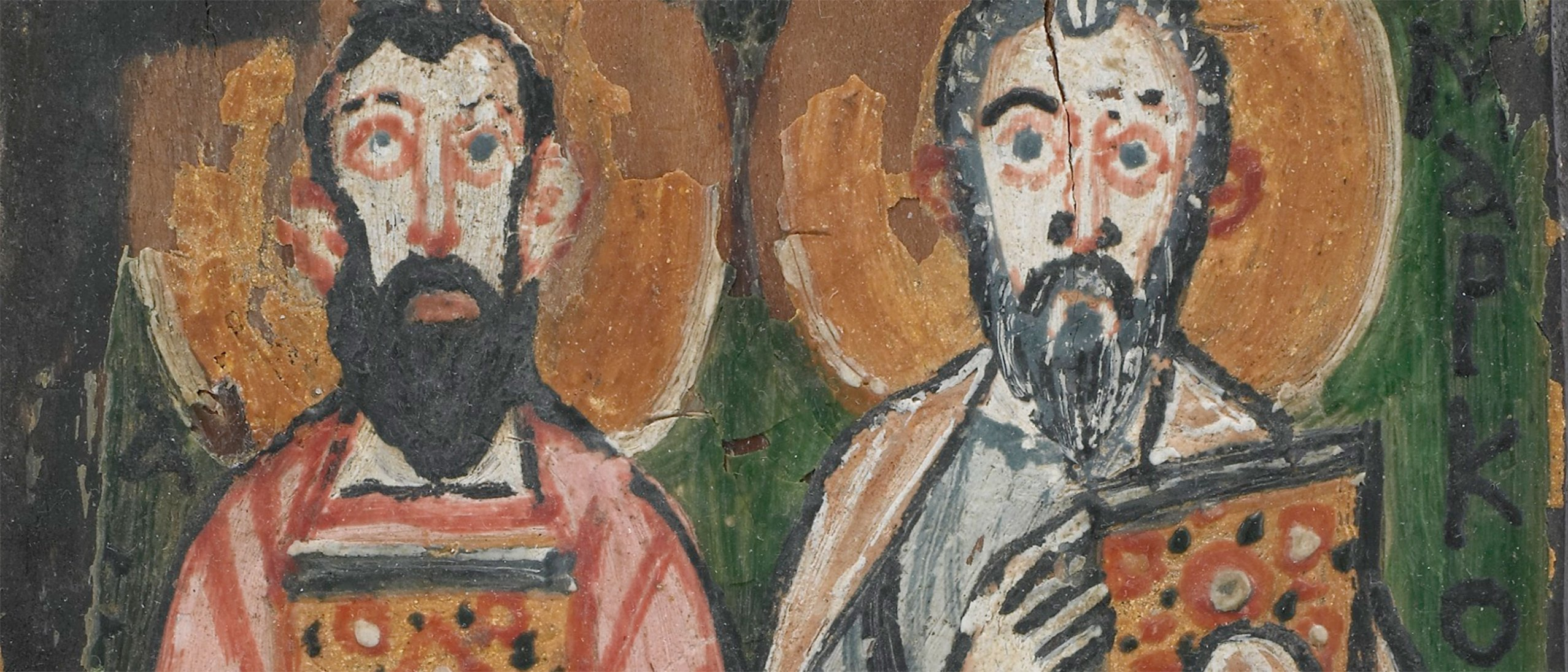 detail of a manuscript cover, two bearded men holding two books, halos behind their heads