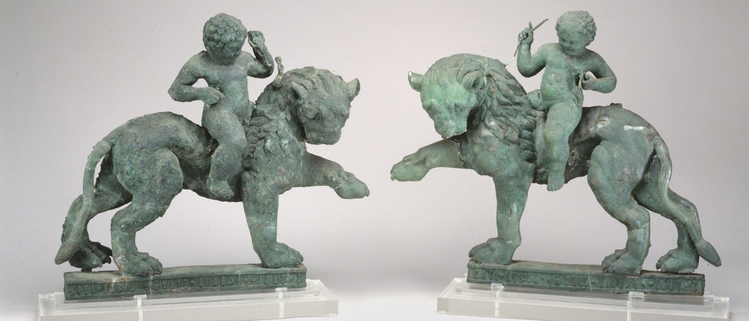 Image detail, Pair of lions with erotes as riders; Figure; early 1st century BCE-mid 1st century CE; Bronze; Yemen; Gift of The American Foundation for the Study of Man (Wendell and Merilyn Phillips Collection); Arthur M. Sackler Gallery S2013.2.77.1-2.