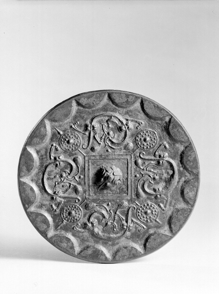 Photo, Bronze mirror. Western Han dynasty, 2nd–1st century BCE., Diam: 12.4 cm. (4 7/8 in.) Singer catalogue number: [1007].
