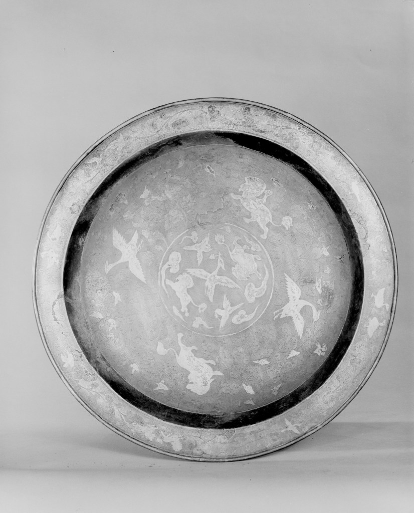 Photo of Gilt silver tray. Tang dynasty, ca. 7th century., Diam: 28 cm. (11 in.). Singer catalogue number: [1438].