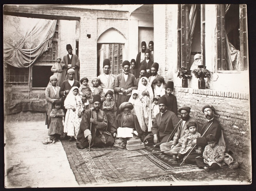 Photo, Hakim Nur-Mahmud (Seated Center with Book) and Family, Patients, Servants; Sevruguin, Antoin,; b&w ; 23.5 cm. x 17.5 cm.; Myron Bement Smith Collection: Antoin Sevruguin Photographs. Freer Gallery of Art and Arthur M. Sackler Gallery Archives. Smithsonian Institution, Washington D.C. Gift of Katherine Dennis Smith, 1973-1985