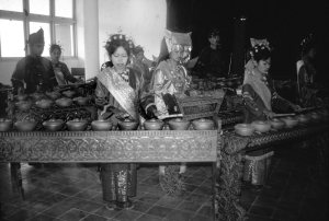 Black and white photo of a a talempong orchestra.
