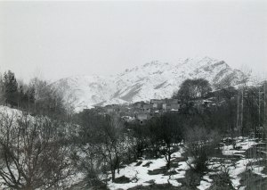 Houses in front of snow-covered mountains in Afghanistan