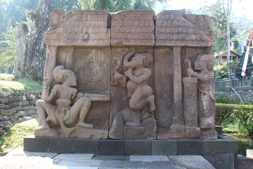 Relief showing two people and a mythological animal