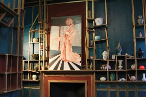An early stage of Waterston's version of Whistler's painting The Princess from the Land of Porcelain rests on the mantel