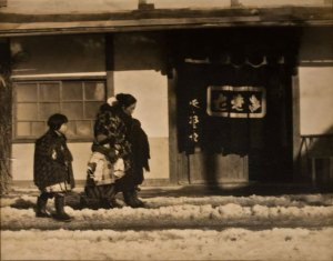 sepia toned photo of three figures outside a building in the snow