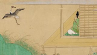 Detail from a scroll on view beginning June 1: Tale of the Crane (Tsuru no monogatari), a crane flying over a green hill near a man sitting in a small building