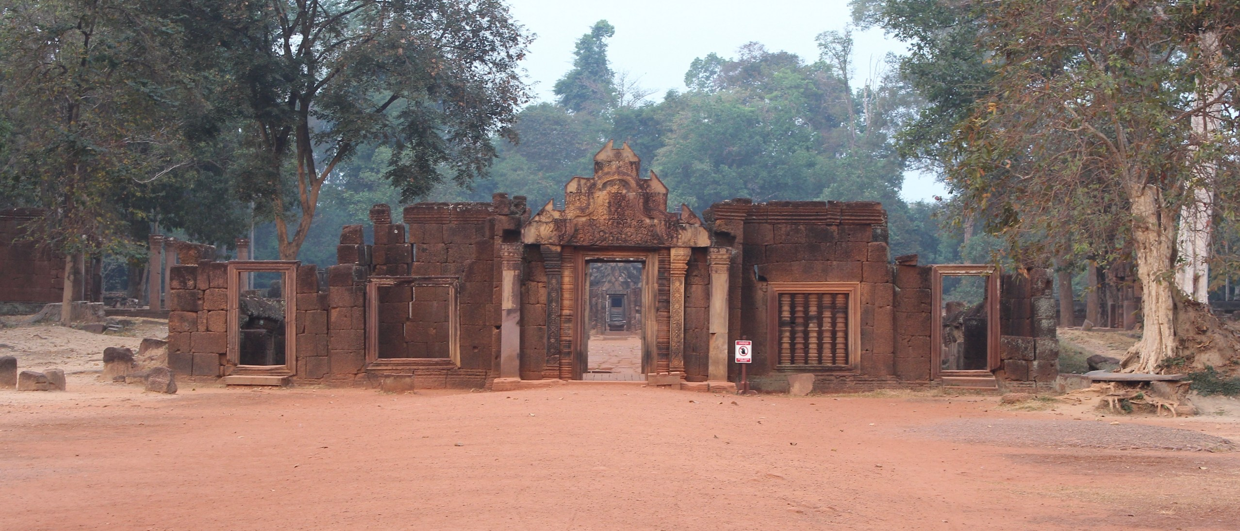 Façade of laterite temple gateway catching first light