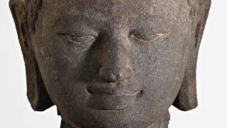 Stone head of a Buddha; a calm expression adorns the face