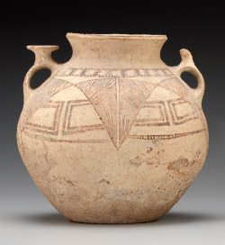 Unglazed clay jar with engravings