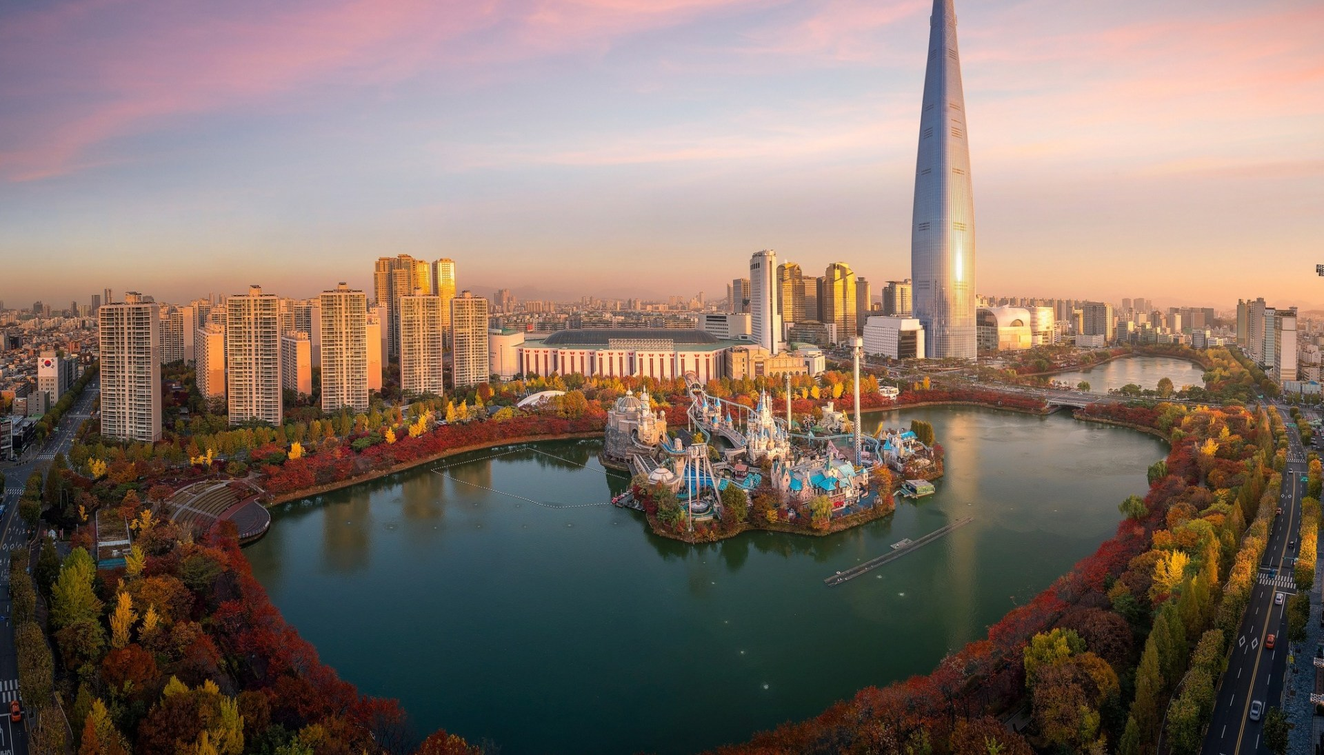 picture of Seoul from above, with a sunrise behind