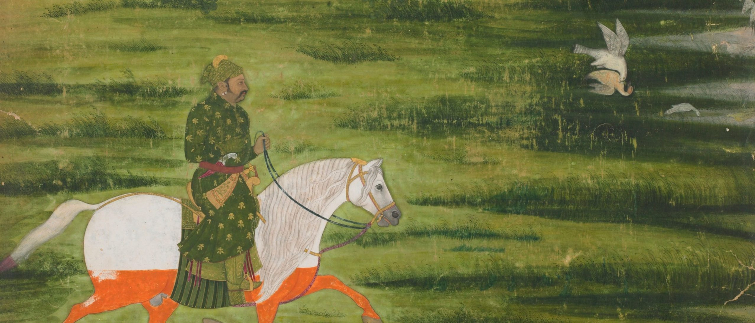 Detail from a painting. A man in green rides a white horse with orange legs across a wide field. A falcon attacks another bird in the upper right corner.