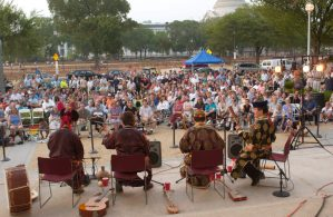 The Tuvan ensemble Huun-Huur-Tu performs for a crowd on the steps of the Freer Gallery.