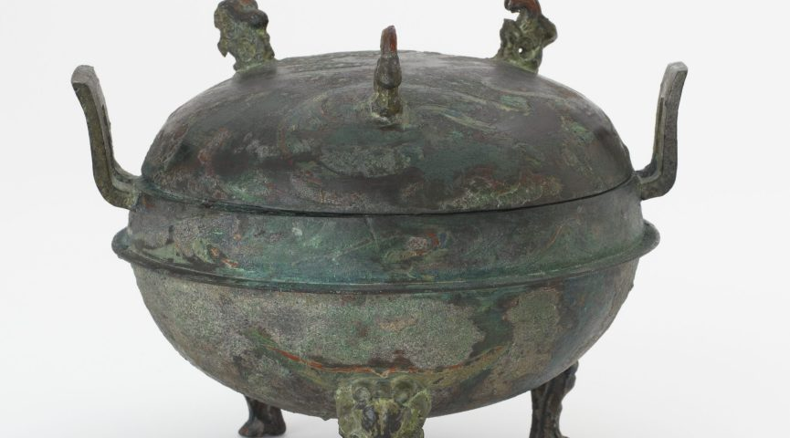 lidded bowl with animals carved on top