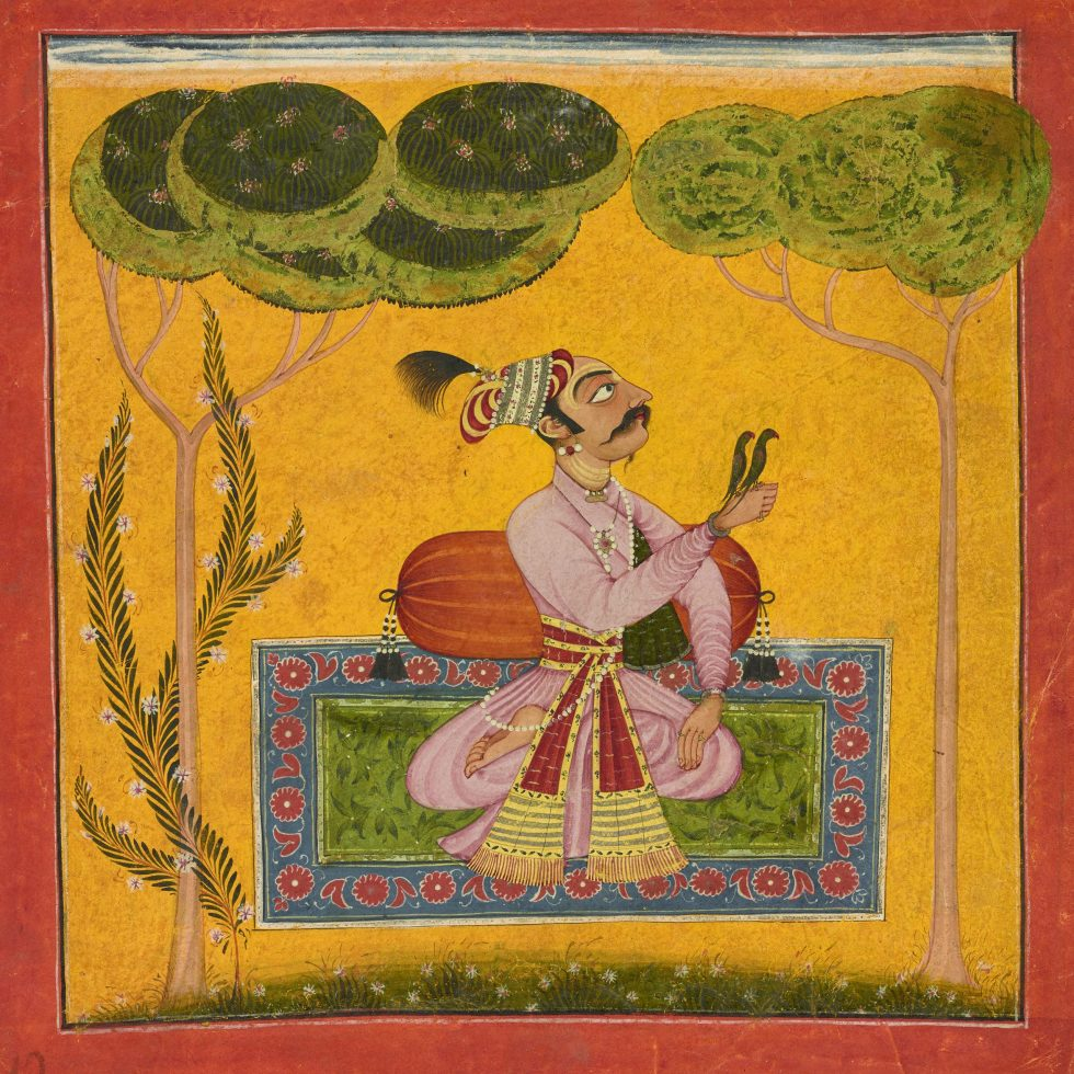A king sitting on a woven rug surrounded by trees, the rug is on a field of yellow, the king is seated against a bolster and two birds are perched on his outstretched hand