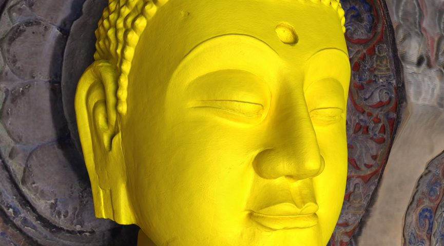 sculpture of a face in yellow