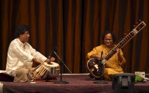 Anindo Chatterjee (left) performs on tabla with Krishna Mohan Bhatt on sitar at the Freer Gallery in 2003.