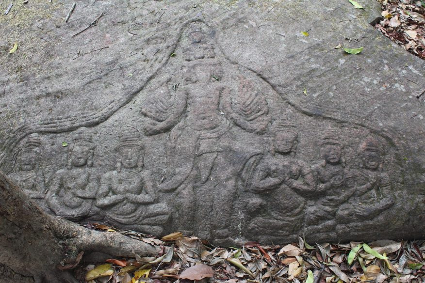 Shallow relief showing multiheaded and multiarmed deity flanked by three devotees on each side