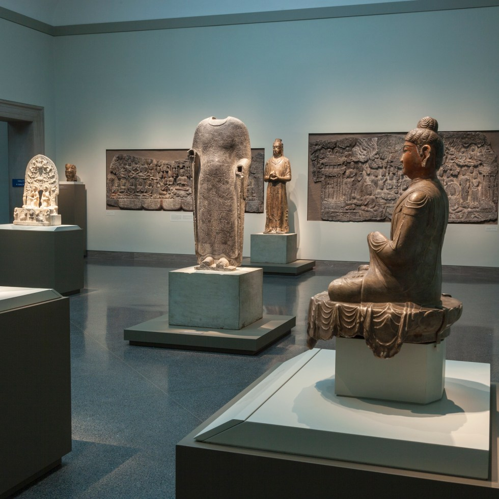 In-gallery photo of Buddhist sculptures at the Freer Gallery of Art
