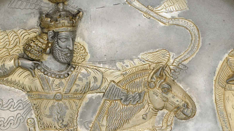detail from the shapur plate, showing a man drawing back a bow, on horseback