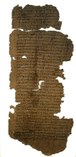 A dark brown papyrus codex, very old and in pieces.