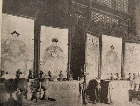 Ancestor portraits hung above altars, Interior of the Shouhuangdian in the Forbidden City, Peking, Republic period, ca. 1930, grainy black and white photograph