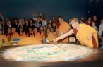 Upon the completion of the mandala, the sand is swept away.