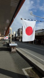 Flags line the street
