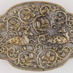 Four-lobed oval box with deer and lion decoration, China, Tang dynasty, circa 825–50, silver, parcel-gilt, 2.5 x 8.9 x 6.4 cm, Asian Civilisations Museum, Singapore, 2005. Photography by Asian Civilisations Museum, Tang Shipwreck Collection